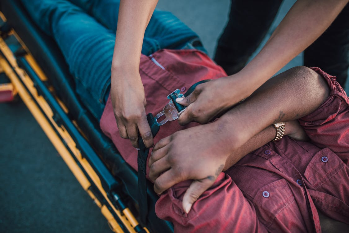 Paramedics helping a victim of a motor vehicle accident